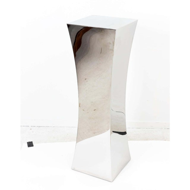 Contemporary mirror polished nickel pedestal with concave shape. sides. The 14.00 inch square top is perfectly sized for...