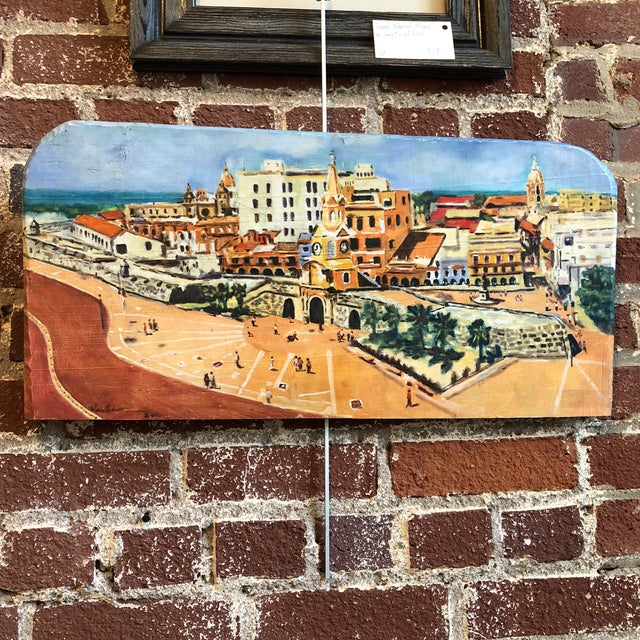Bright and cheerful coastal cityscape painting of Ciudad Viega, Cartagena, Columbia painted on board. At the center of the...
