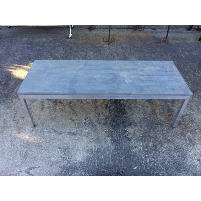 Slate coffee table with aluminum base. Perfect for both in or outdoors. Sleek lines and muted gray tone make up this...