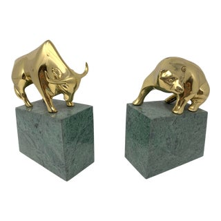 Modern Brass Bull and Bear Bookends on Stone Pedestals - a Pair For Sale