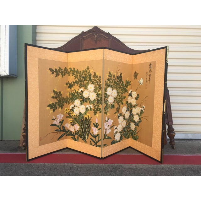 Striking hand painted antique screen with florals and butterflies in green, pink, purple, white and gold. Each panel is...