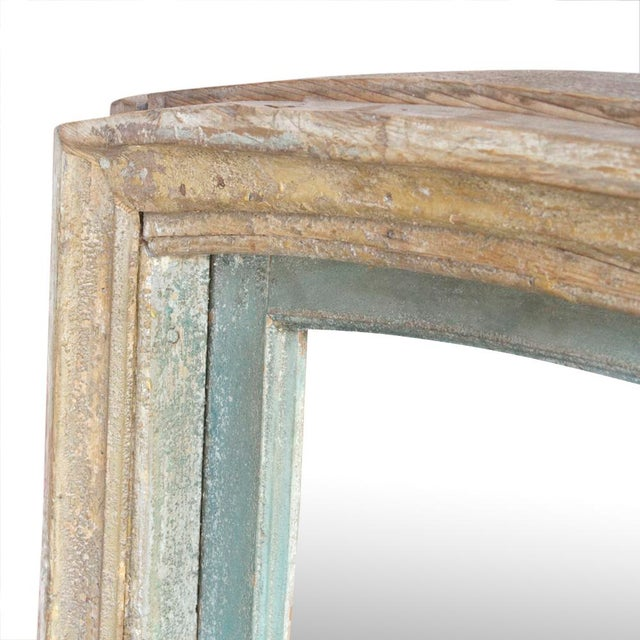 19th Century Indo French mirror with beautiful dome top and original traces of painted aqua and yellow finish.