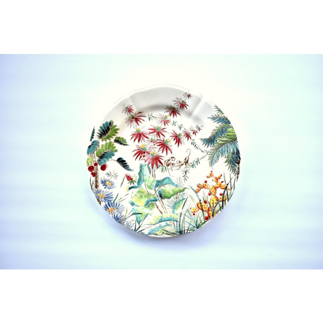 "A vintage French Gien pottery 9"" luncheon plate in the ""Tamarin"" pattern, with tropical flowers and monkey sLightly..."