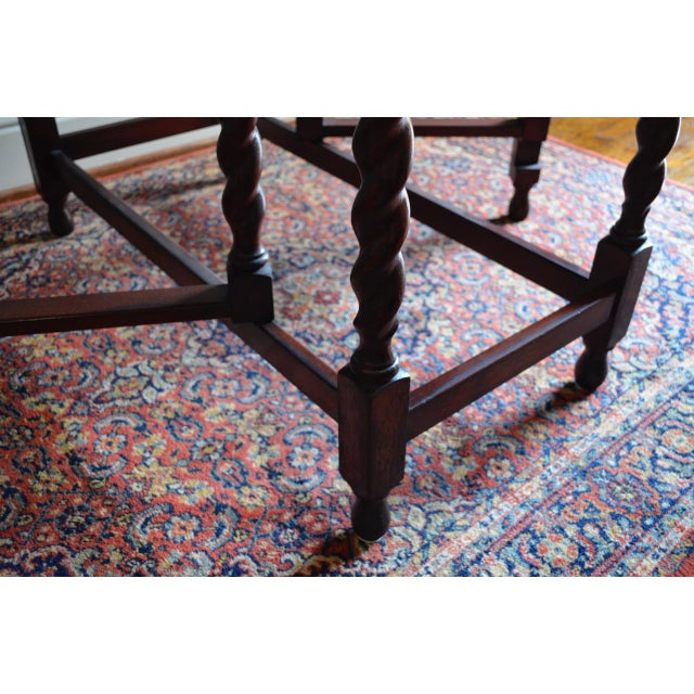 A versatile antique gate leg table that can be used as side table and pulled out for extra dining space. This has been...
