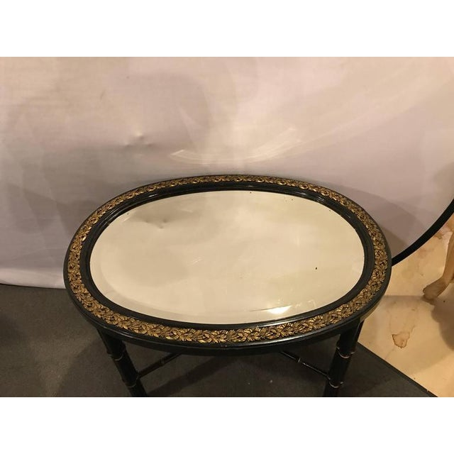 Hollywood Regency Hollywood Regency Beveled Mirror Top Black Oval Coffee Table With Bronze Mounts For Sale - Image 3 of 9