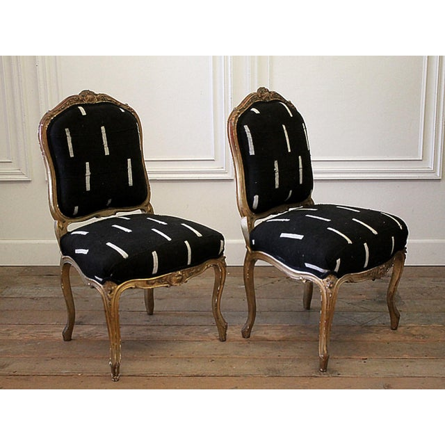 Late 19th Century Giltwood Louis XV Style French Chairs in Vintage Upholstery Beautiful side chairs upholstered in a black...