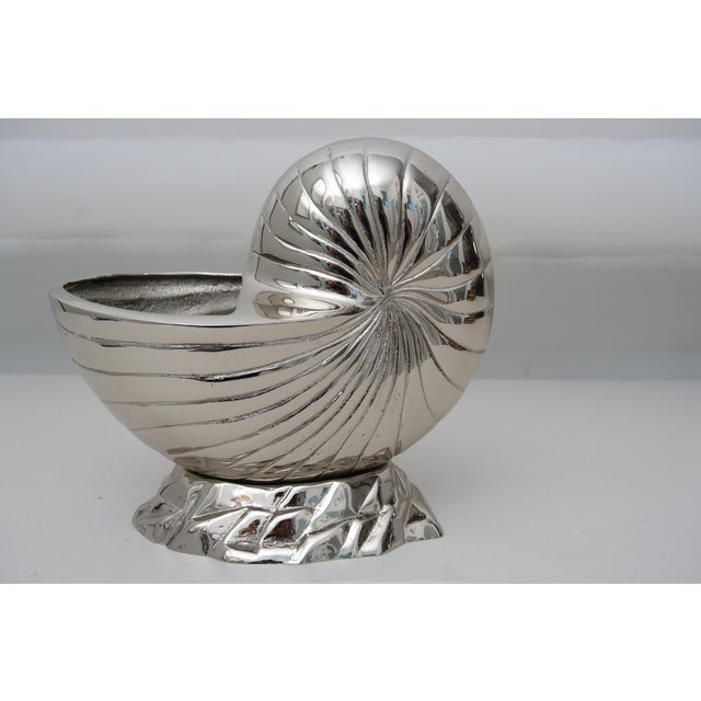 This stylish nautilus-form piece could be used as a cachepot or perhaps as a serving piece. The piece is lacquered so no...