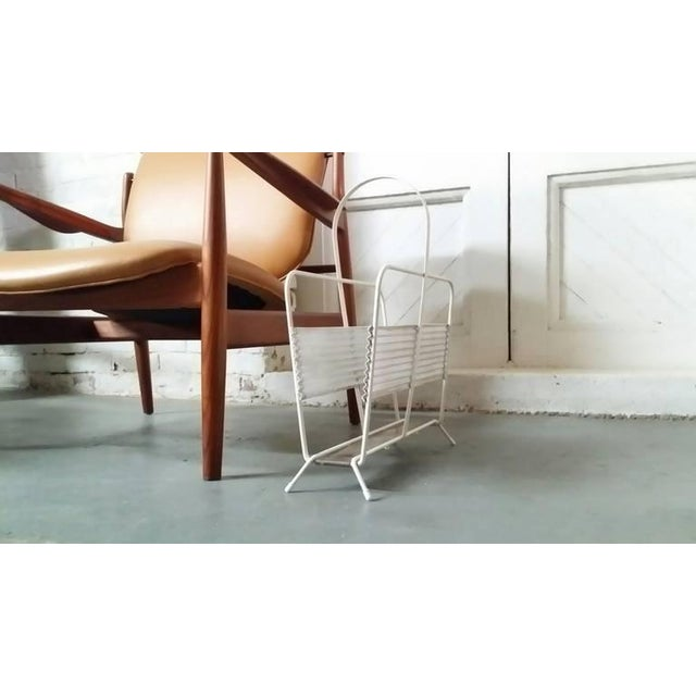 Magazine rack designed by Mathieu Matégot, France circa 1950's. We offer free delivery on most of our items within the...