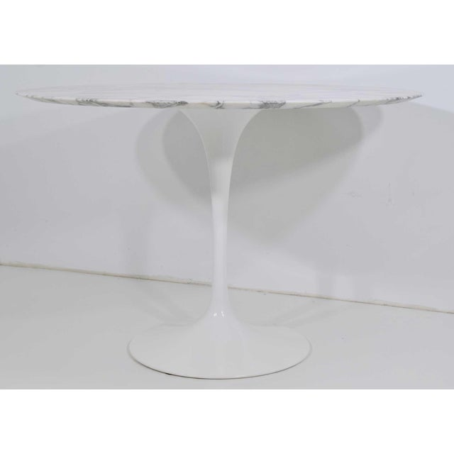 Knoll white tulip table with arabescato marble top.