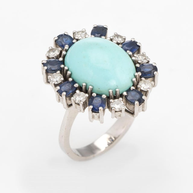 Distinct & stylish egg shell blue turquoise, sapphire & diamond ring (circa 1950s to 1960s), crafted in 18 karat white...