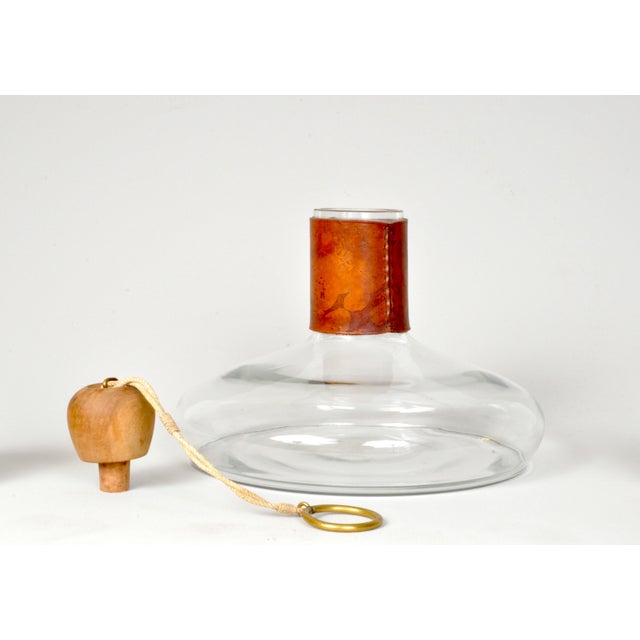 Vintage wine decanter designed and executed by the Carl Aubock workshop, Vienna Austria. This wonderful leather clad...