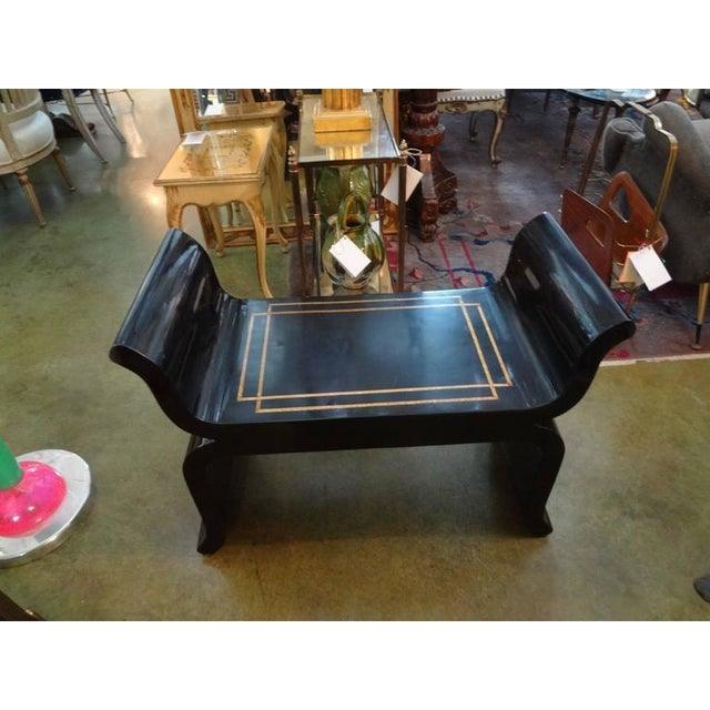 Stylish pair of Hollywood Regency Asian modern black lacquered benches with gilt geometric design. Attributed to James Mont.