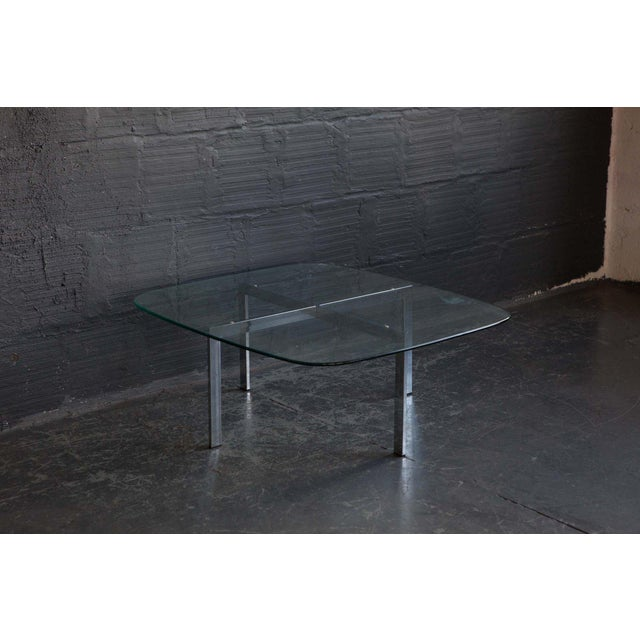 Chrome plated table with rounded glass edges. This piece is a sleek American made coffee table. Origin / Circa: USA Please...