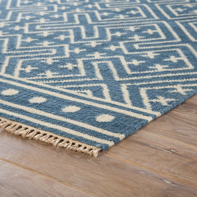 This global-inspired flatweave area rug boasts a captivating graphic pattern, recalling angular chinoiserie motifs. A...
