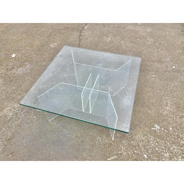 Midcentury modern minimal coffee table with really cool geometric angled lucite base and a thick square glass top.