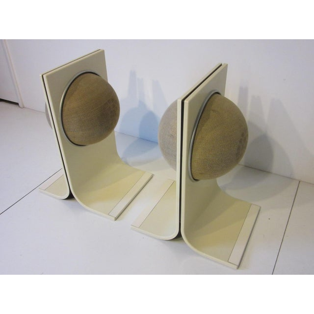 A pair of ABS formed plastic cabinets with ball speakers to each side suspended in the ball which denotes the manufactures...