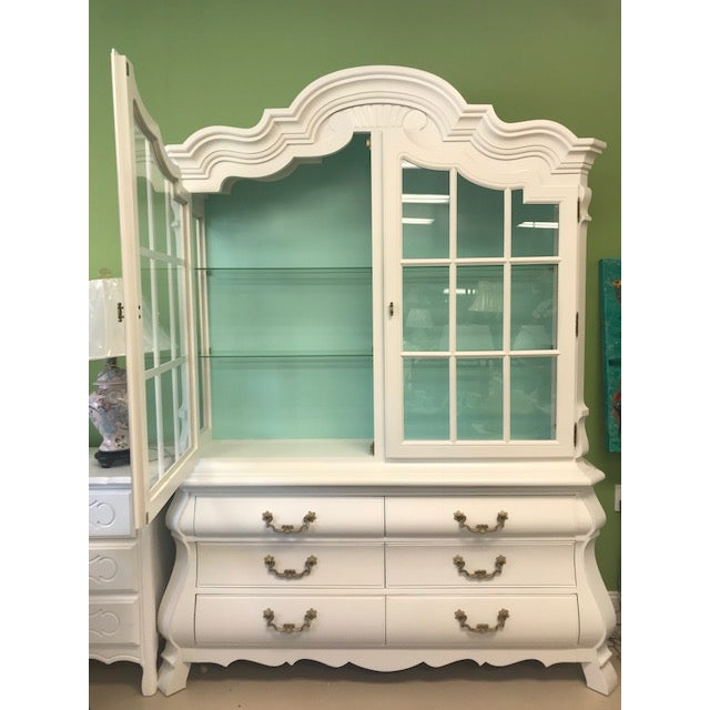 Vintage china cabinet or display. Lacquered white with aqua inside, original hardware. The glass has a small piece broken...