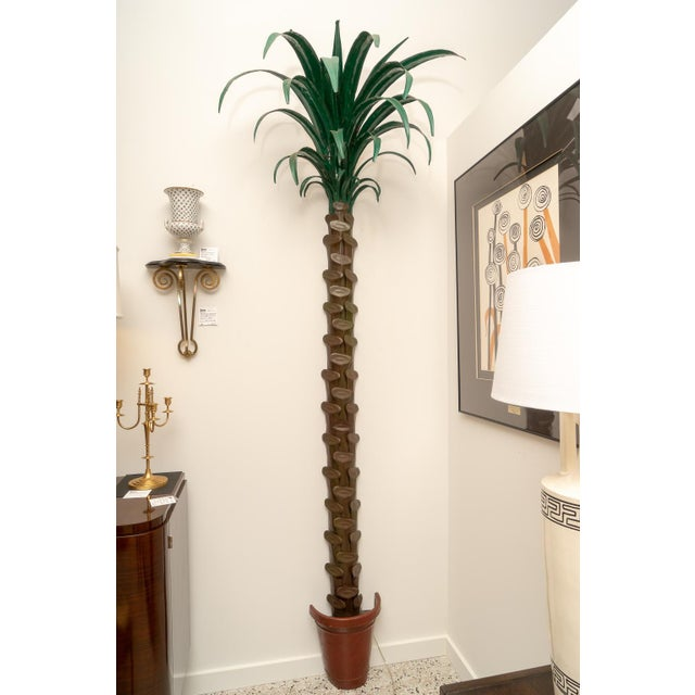 This stylish and chic set of palm tree form torcheres were acquired from a Palm Beach estate and they date to the 1970s....