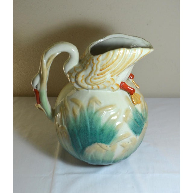 You are viewing a fascinating large majolica pitcher featuring the full body of a swan as the pour spout and the handle!...
