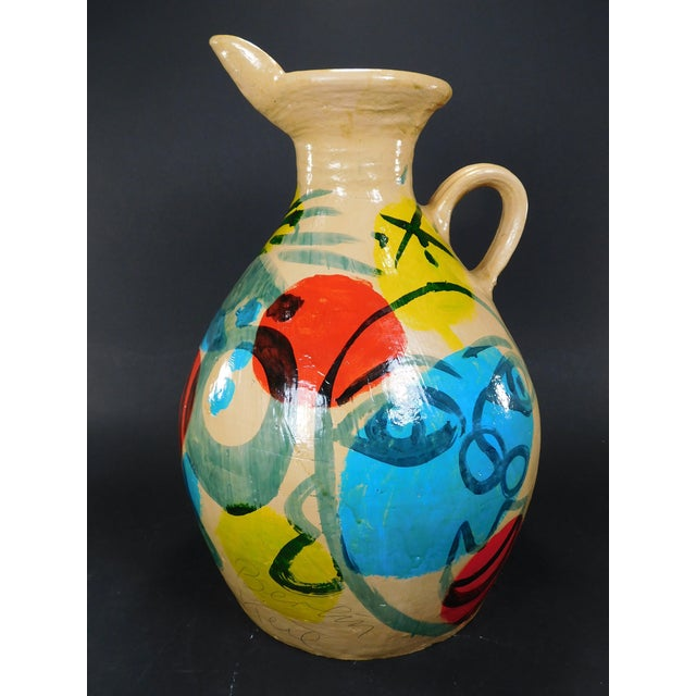 Peter Keil painted jug. Brilliantly painted abstract faces throughout. This vase is very rare from the artist who is...