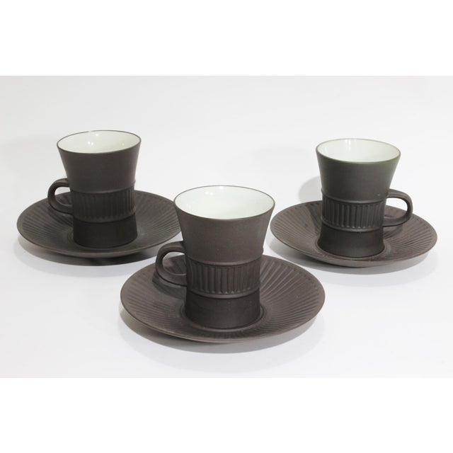 Classic Dansk 1960s coffee service in the distinctive chocolate brown matte glaze with fluted design by Jens Quistgaard....