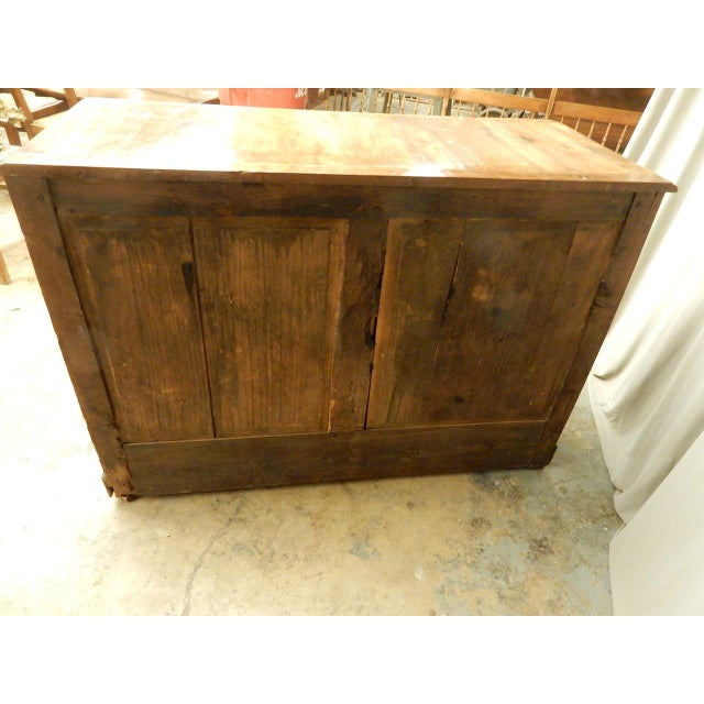 Early 19th century French Directoire' Buffet. Has a beautiful faded walnut honey colored patina. Carefully restored to...