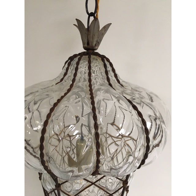 Murano is known for beautiful color blown glass, yet this fixture is clear and amazing. Baloton is a style of letting the...
