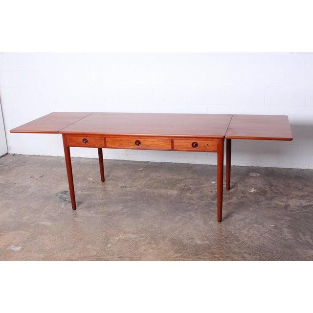 """A teak drop-leaf table or desk AT305 designed by Hans Wegner. Measure: 91"""" fully extended."""