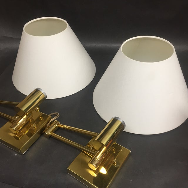 Pair of Casella Wall Lamps in Great condition. Satin brass finish with linen diffused shade and dimmer. Some slight...