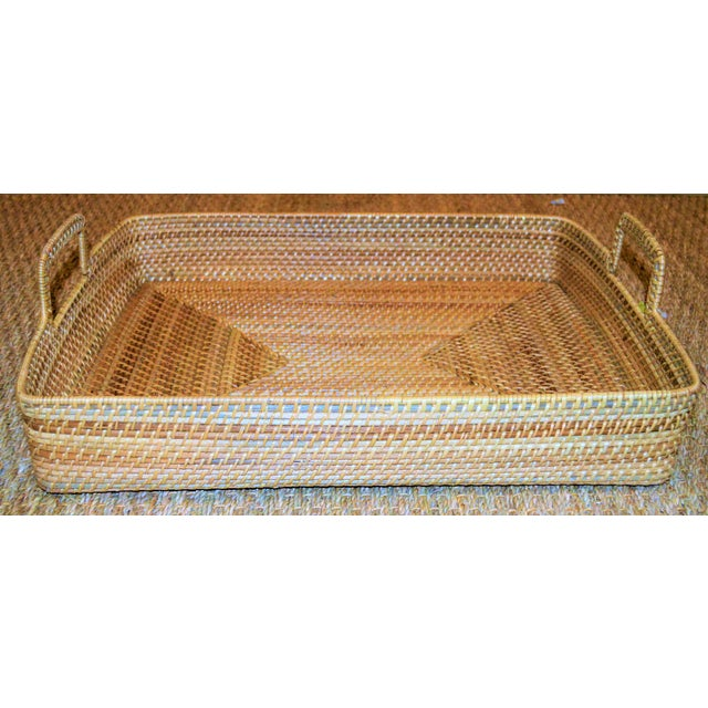 """This is a hand woven rattan rectangular serving tray. This tray is 22.5 """" long, 16.75"""" wide and 3.75 inches tall (with..."""