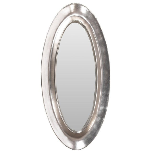 Monumental oval hand cast plaster mirror with applied aluminum leaf. Handmade by artist Lawrence De Martino, circa 1990s.