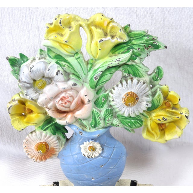 A very pretty small to medium size vintage cast iron Garden Flower doorstop. Made by the Hubley Foundry USA. Circa 1920s....