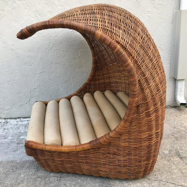 "Italian midcentury ""Wave"" rattan lounge, a luxurious roomy sculptural lounge, a rare find. The opening of the lounge is..."