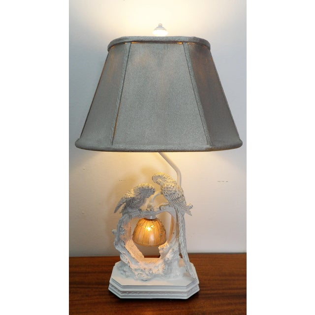 Whimsical Composite Lamp featuring a pair of Parakeets. There are two lights on the lamp with multiple settings (lower...