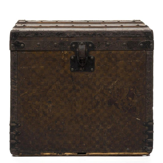 Damier pattern steamer trunk with original inserts by Louis Vuitton, 1890s. From the first run Damier pattern production...