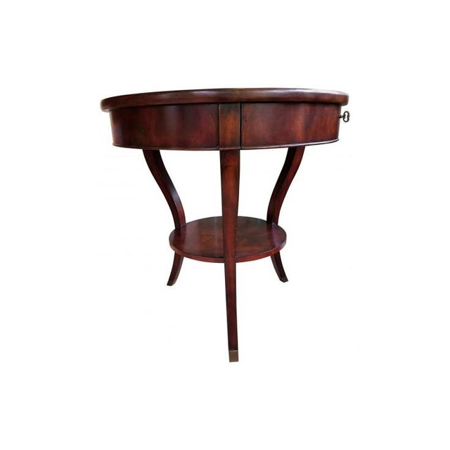 MAHOGANY BEDSIDE TABLE BY RALPH LAUREN, the circular top above a deep frieze with single pull out drawer, raised on...