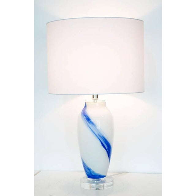 The prettiest hues of blue meet milky in our Blue Sky Lamp. Handblown Glass body with Crystal Base and Finial. Off white...