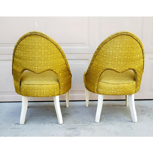 Vintage spoon back chairs. Believed to be from the 1930s and reupholstered in the 50s. The legs have been restored to...
