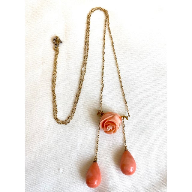 Fine, elegant Antique 14k gold chain necklace with a bar pendant set with a carved coral rose and embellished with two...