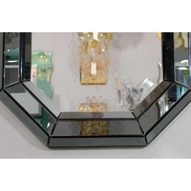 Custom smoked glass mirror.