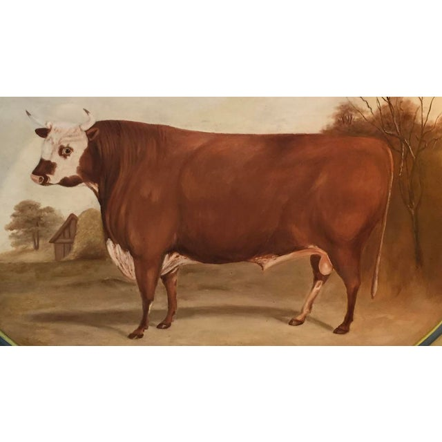 Large vintage tole' tray depicting a bull in a landscape. Hand painted and signed by the artist.
