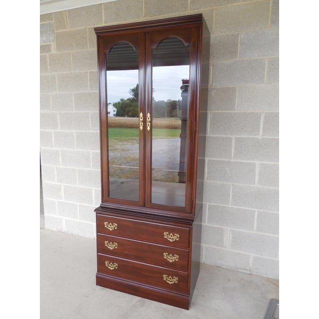 This Ethan Allen Georgian Court bookcase features quality construction, traditional styling, and three dovetailed drawers....