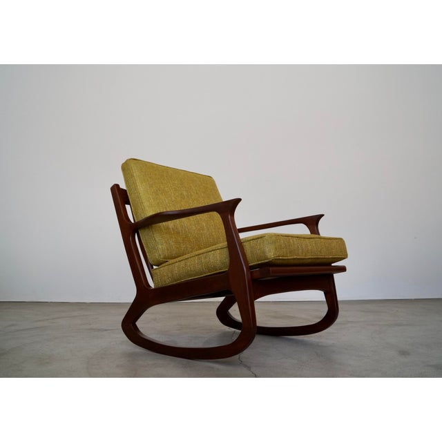 Vintage 1950's Mid-century Modern rocking chair for sale. Designed by IB Kofod-Larsen, and is an original lounge chair. It...