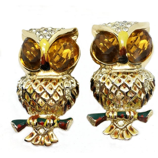 1940s Coro Craft Duette gold tone metal owl brooch/clips set with large topaz faceted glass eyes and embellished with...