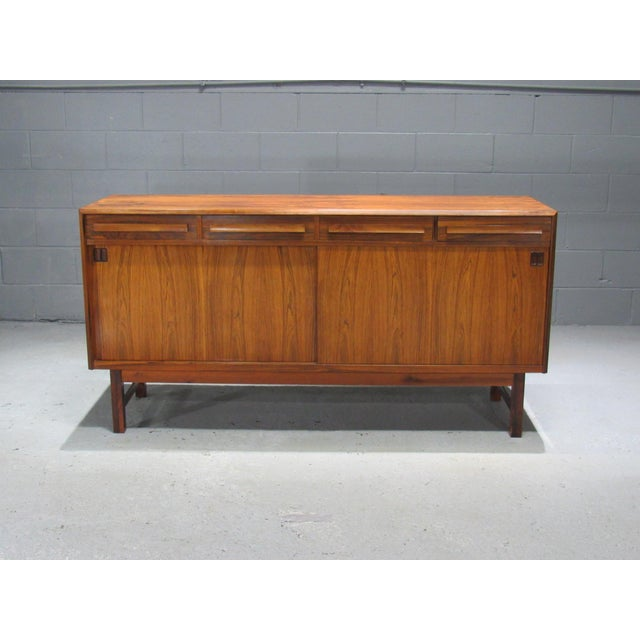 Danish Modern rosewood sideboard by Bordum OG Nielsen, This sideboard features a beautiful rosewood grain. With four...