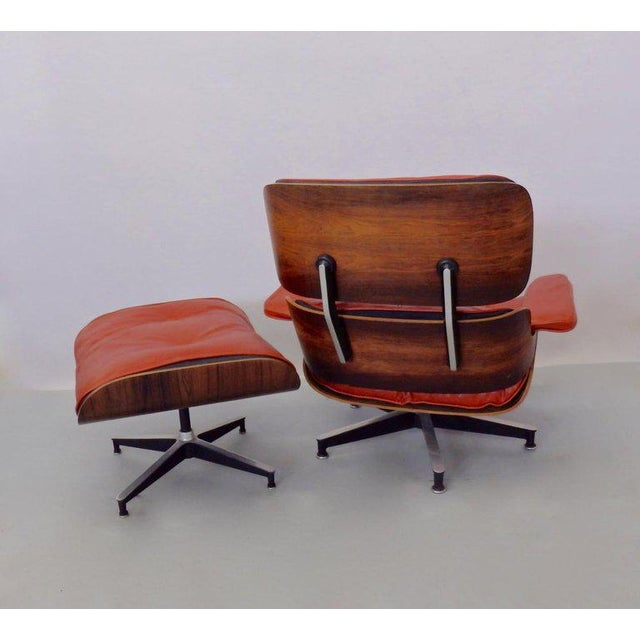 Very nice earlier production chair with ottoman. Chair retains original white disc label. Beautiful rosewood grain in...
