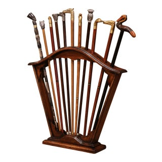 Early 20th Century French Carved Walnut Cane Stand With Eleven Antique Canes For Sale