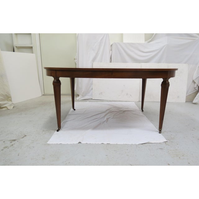 Mid century Belvedere oval dining table by Kindel Furniture. High quality, made of cherry wood, it includes 3 matching...