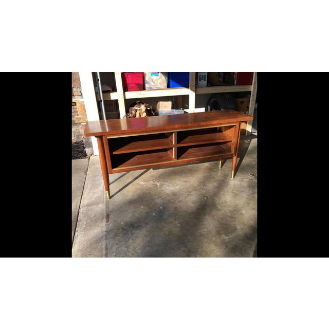 Wonderfully unique vintage mid century modern with floating top. I think it might be teak. I love this piece even though...