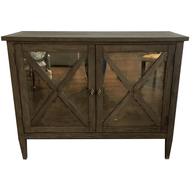 This product features a bleached mahogany and select hardwoods in a warm grey finish with hand wire brushing. Features...
